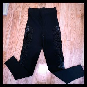 Bebe black cutout lace detail leggings.